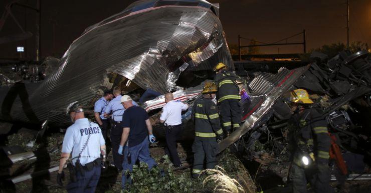Emergency personnel work the scene of a train wreck, Philadelphia