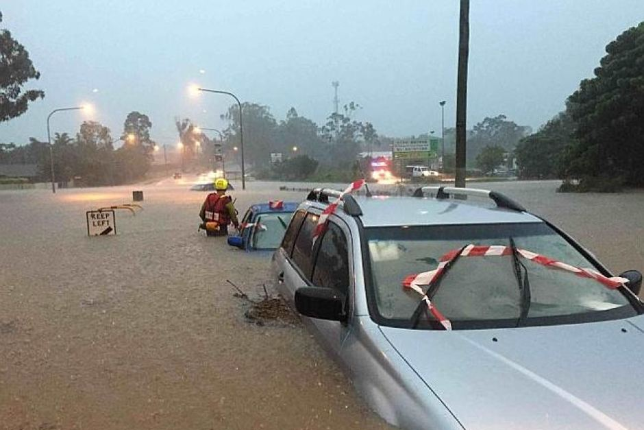 Swift water rescue teams checking cars in Brisbane.