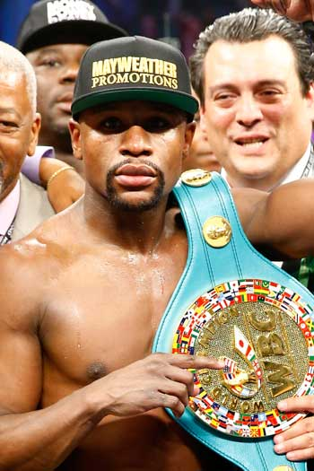 Mayweather with his WBC welterweight title belt. Photo: Getty