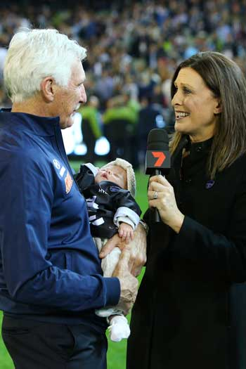 Mick Malthouse's interview with his daughter and granddaughter has been perhaps the most compelling moment of Friday night footy this year. But the match was a train wreck. Photo: Getty