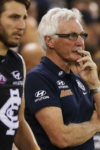 Malthouse and Dale Thomas survey the carnage against GWS. Photo: Getty