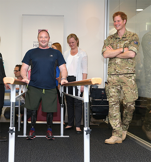 Prince Harry with Lt Alistair Spearing. Photo: Getty