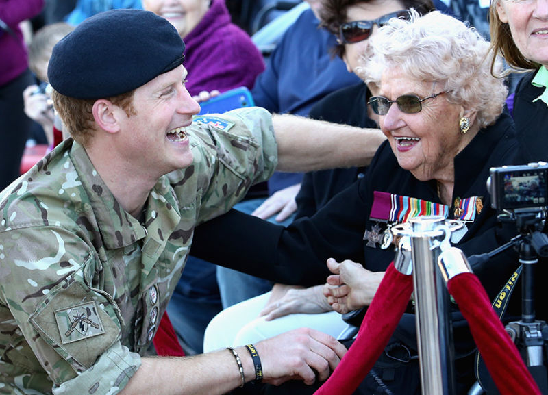 Prince Harry with Daphne Dunne (wearing her husband's Victoria Cross).