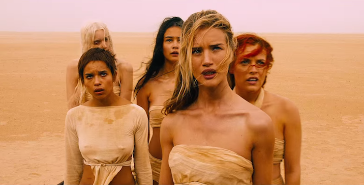 (L-R): Abbey Lee Kershaw, Zoe Kravitz, Courtney Eaton, Rosie Huntington-Whiteley and Riley Keough play the wives.