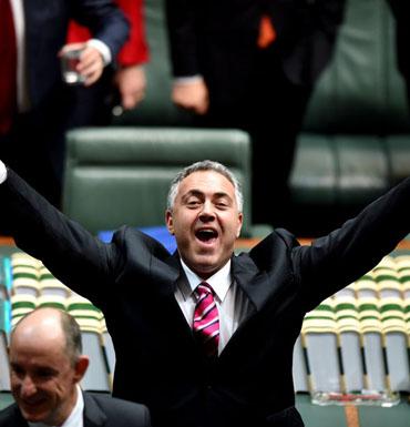 Treasurer Joe Hockey celebrates the end of the speech.