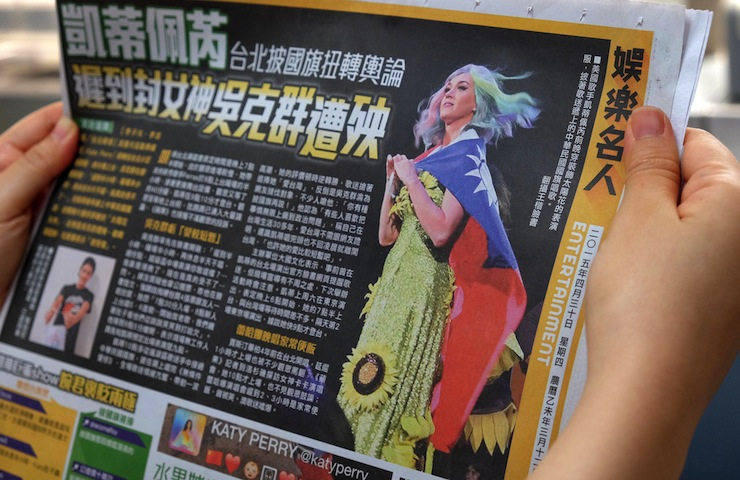A newspaper in Taipei features an article about Perry's controversial costume. Photo: AAP