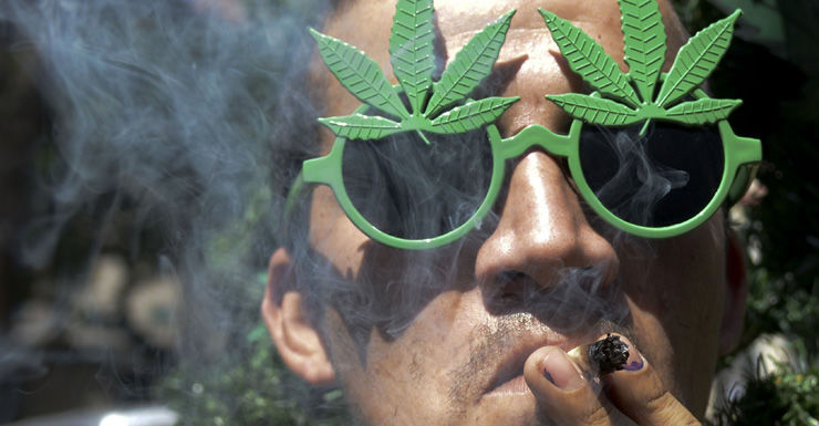 man smokes marijuana. Getty