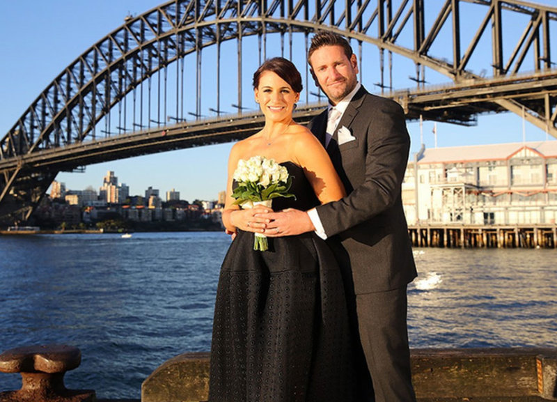 Clare and Lachlan celebrate their TV marriage under the Sydney Harbour Bridge.