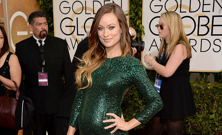 Olivia Wilde proudly shows off her mumbod on the red carpet. Photo: Getty