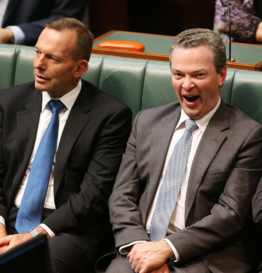 Education Minister Christopher Pyne yawns mid-speech.