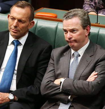 Minister for Education and Training Christopher Pyne reacts to Mr Shorten's budget reply speech.