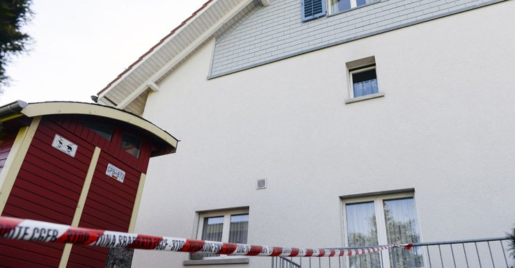 Police have blocked the way to a house in Wuerenlingen, Switzerland, where they found several people dead.