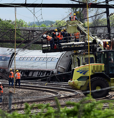 Rescuers work around derailed carriages of an Amtrak train in Philadelphia.