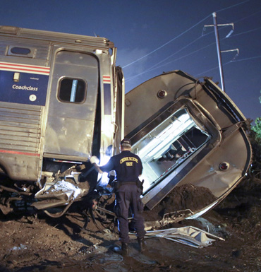 Emergency personnel work the scene of a deadly train wreck in Philadelphia.