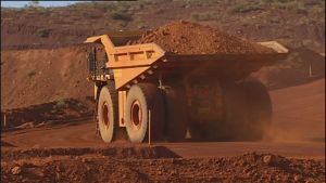 The mining downturn is weighing on investment, even as the production boom boosts exports.