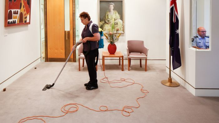 A cleaner vacuuming the Prime Minister's office at Parliament House in Canberra.