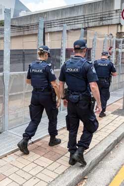 Queensland police walk the streets of Brisbane. Photo: Getty
