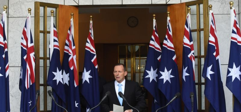 abbott-10-flags-260615-newdaily