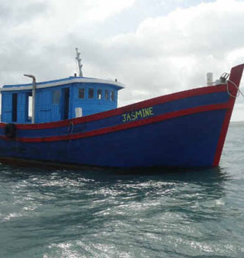 The Jasmine, which Indonesian police say was given to people smugglers by Australian authorities before running aground on a reef