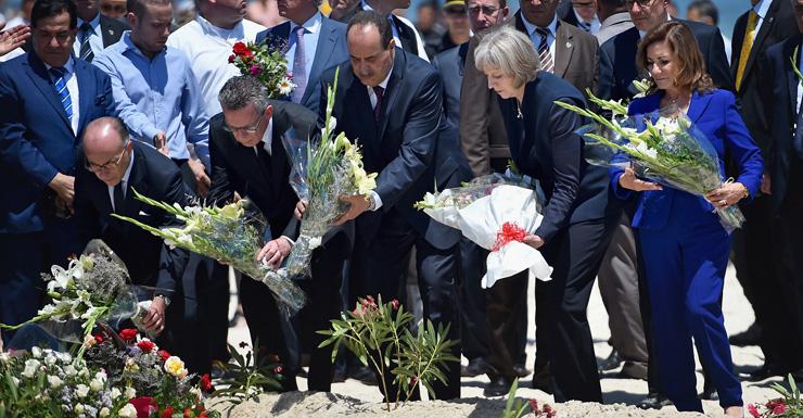 Ministers lay flowers where 38 people were killed on Marhaba beach, Tunisia.