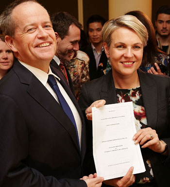Mr Shorten and Ms Plibersek pose with the same-sex marriage bill.