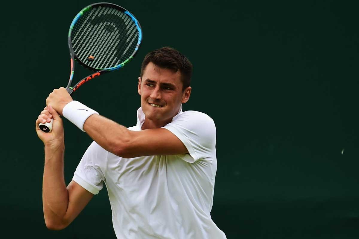 Tomic during his third-round loss to Novak Djokovic at Wimbledon. Photo: Getty