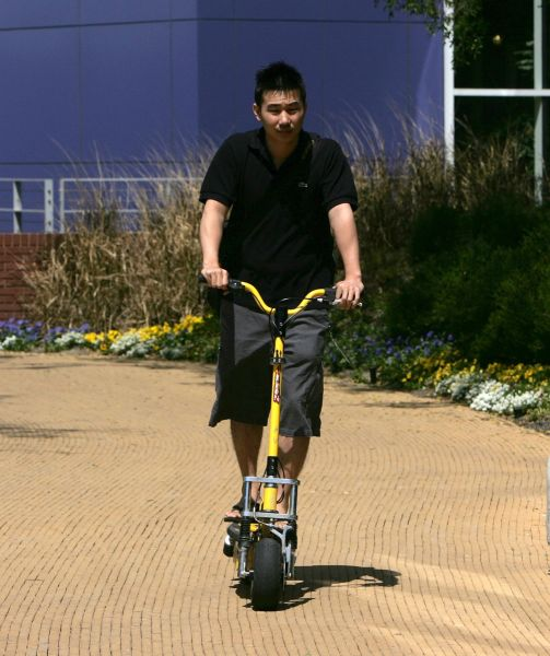 A Google employee rides his scooter at the Google Campus. Photo: Getty