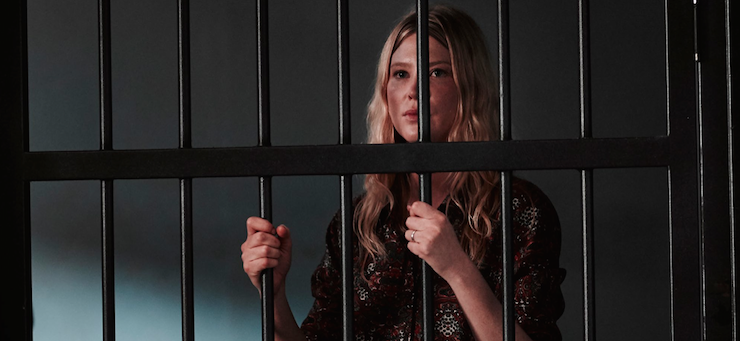 The back-from-the-dead Kate (Emma Booth) behind bars.