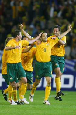 Skoko (c) is mobbed by team-mates after scoring against Greece in 2006. Photo: Getty