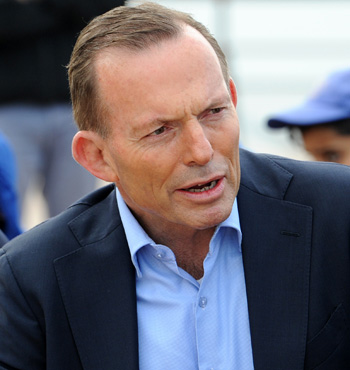 """Mr Abbott repeated the ETS criticism on Monday, calling the policy an """"electricity tax scam""""."""