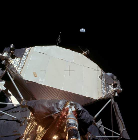 You can see the earth out in the distance, hovering above the lunar landing module. Photo: NASA