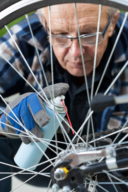 A man cleans his bike. Photo: Shutterstock