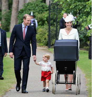 The Duke and Duchess of Cambridge and Prince George stroll with Princess Charlotte.