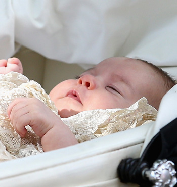 Princess Charlotte of Cambridge is pushed in her silver cross pram.