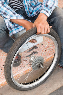 With the right tools, replacing a tyre is fairly easy. Photo: Shutterstock