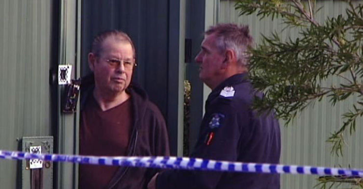 George Williams with police after shots were fired into his home Monday.