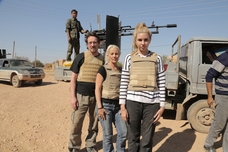 The contestants wear bullet-proof vests in Syria.