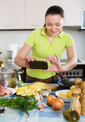 Snapping food photos while cooking is a bad idea for hygiene reasons. Photo: Shutterstock
