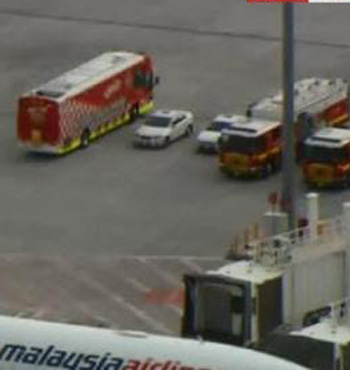 Emergency services on the tarmac.