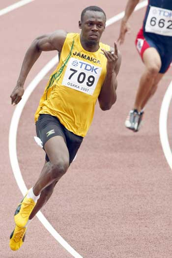 Bolt running the 200m at the 2007 World Championships. Photo: Getty