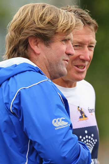 Hasler with Melbourne Storm counterpart Craig Bellamy. Photo: Getty