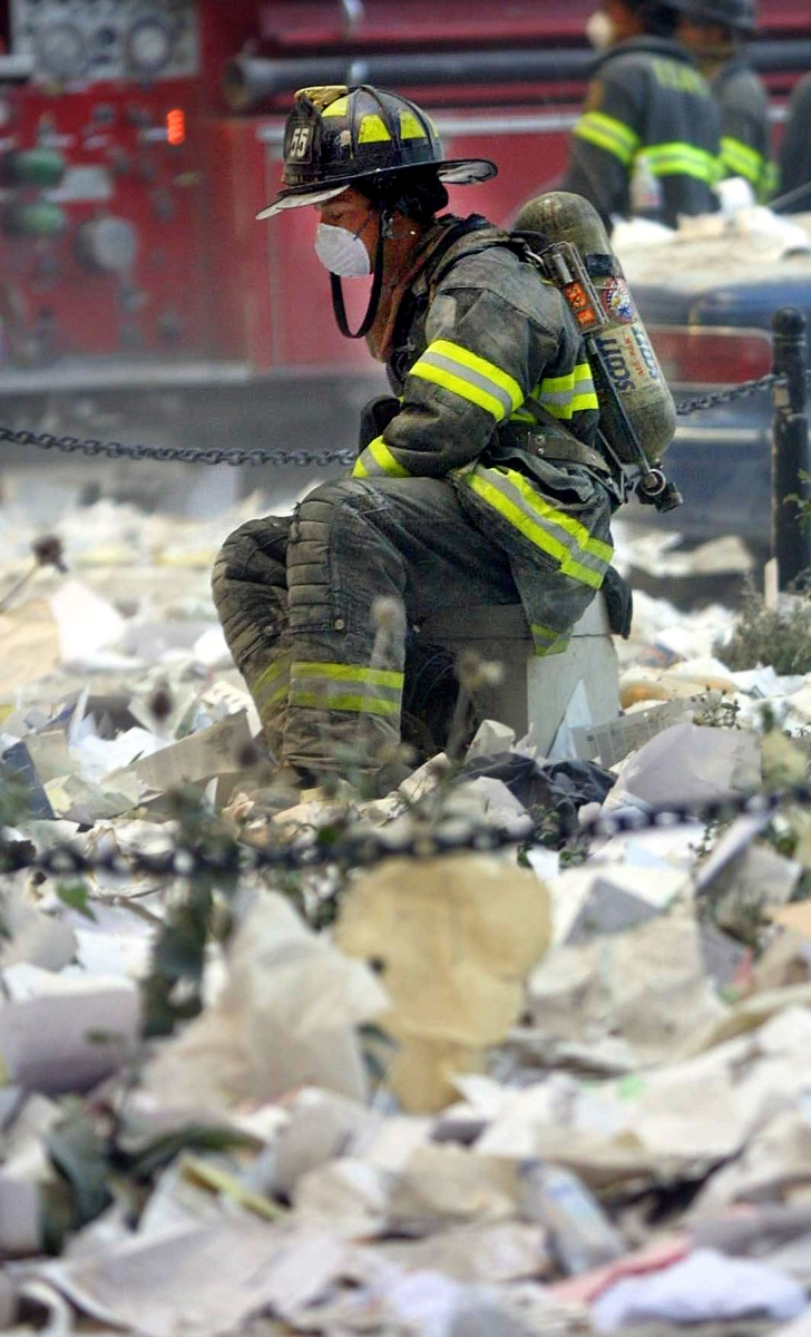 A firefighter rests at ground zero after the World Trade Centre collapse. Photo: Getty