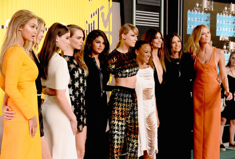 Taylor Swift walks the carpet with her 'Bad Blood' crew (L-R): Gigi Hadid, Martha Hunt, Hailee Steinfeld, Cara Delevingne, Selena Gomez. Taylor Swift, Serayah McNeill, Lily Aldridge, Mariska Hargitay and Karlie Kloss.