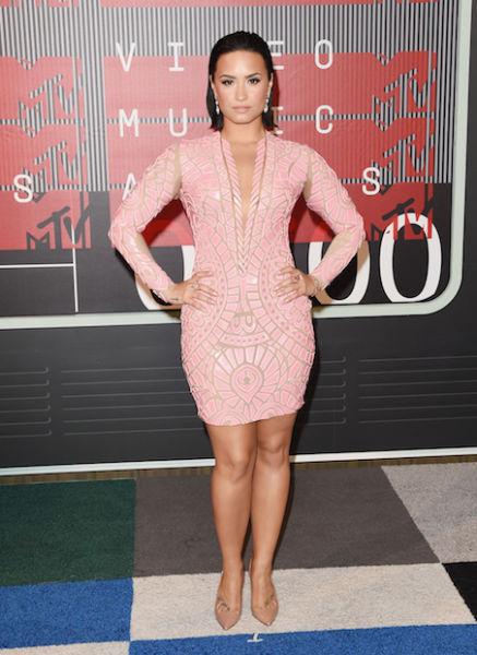 Demi Lovato in pale pink.