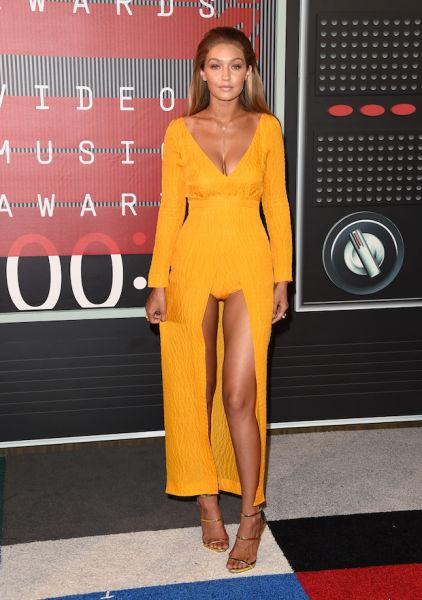 Model Gigi Hadid opts for orange, hold the pants.