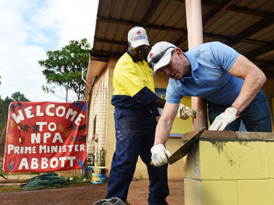 Prime minister Tony Abbott helps to renovate a hall in Injinoo on the Northern Peninsular, Thursday, Aug. 27, 2015. The prime minister is visiting the region as part of his annual week in indigenous communities. (AAP Image/Tracey Nearmy) NO ARCHIVING