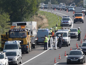 Investigators examine the truck, which was found near the border of Hungary and Austria. Photo: AAP