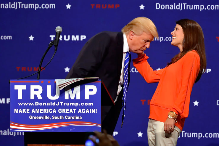 Republican supporter Mary Margaret Bannister tussles Donald Trump's hair. Photo: AAP