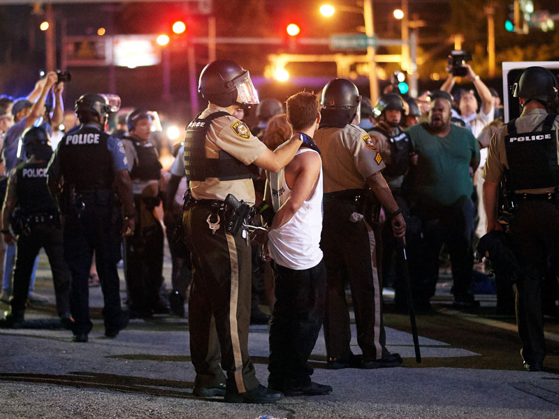 Police detain a man during a civil disobedience action in Ferguson, Missouri.