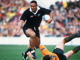 Lomu slips the tackle of Jason Little in the 1995 Bledisloe Cup.